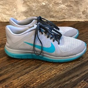 Nike Shoes - Blue and Teal Nike Free 4.0 Shoes Size 9
